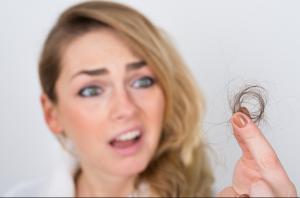 female hair loss sad