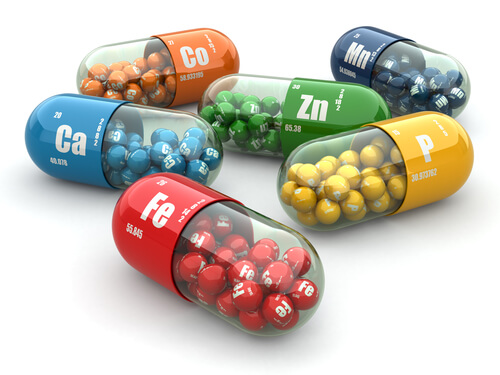 An array of colorful vitamin capsules