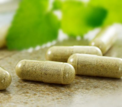 Hair loss supplement capsules on a table