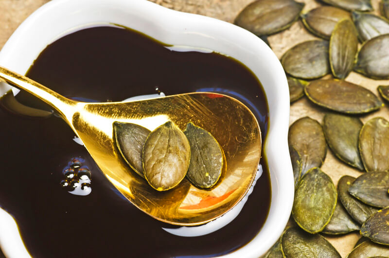 A spoonful of pumpkin seeds and pumpkin seed oil